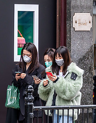 © Licensed to London News Pictures. 13/03/2020. London, UK. Shoppers in masks in Knightsbridge outside Harrods. Knightsbridge appears very quiet this morning as Prime Minister Boris Johnson warned that anyone with cold like symptoms should self-isolate as the World Health Organization declares that the Coronavirus disease is a Pandemic. Photo credit: Alex Lentati/LNP