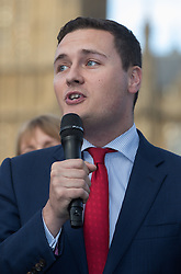 Parliament Square, Westminster, London, June 17th 2016. Following the murder of Jo Cox MP a vigil is held as friends and members of the public lay flowers, light candles and leave notes of condolence and love in Parliament Square, opposite the House of Commons. PICTURED: Wes Stressing MP, a close friend of Jo Cox speaks to the assembled crowd.