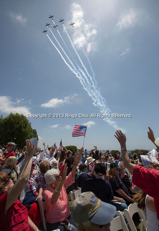CJ-6A jets fly over in a missing man formation during the Memorial Day Observance Monday, May, 27, 2013, at Green Hills Memorial Park in Rancho Palos Verdes, California.(Photo by Ringo Chiu/PHOTOFORMULA.com).