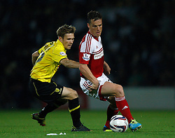 Fulham's Scott Parker battles with Burton Albion's Jimmy Phillips - Photo mandatory by-line: Matt Bunn/JMP - Tel: Mobile: 07966 386802 27/08/2013 - SPORT - FOOTBALL - Pirelli Stadium - Burton - Burton Albion V Fulham -  Capital One Cup - Round 2
