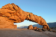 Sunset light bathes Sunset Arch in the desert of Escalante-Grand Staircase National Monument, Utah