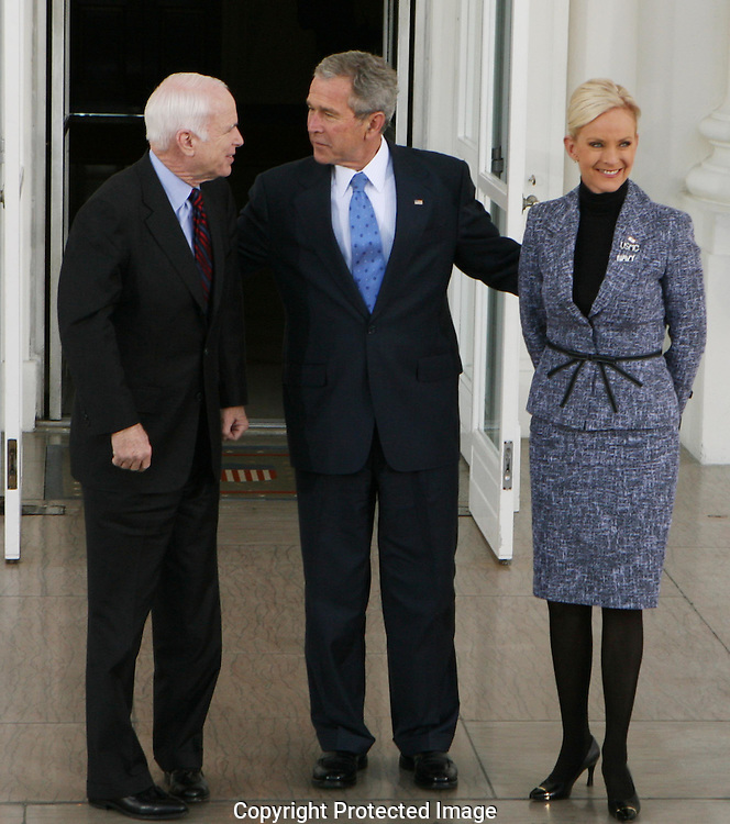 President George W. Bush greets Republican Presidential nominee Senator John McCain R-AZ  and Cindy McCain at the North Portico  of the White House on March 5, 2008.  Photograph: Dennis Brack