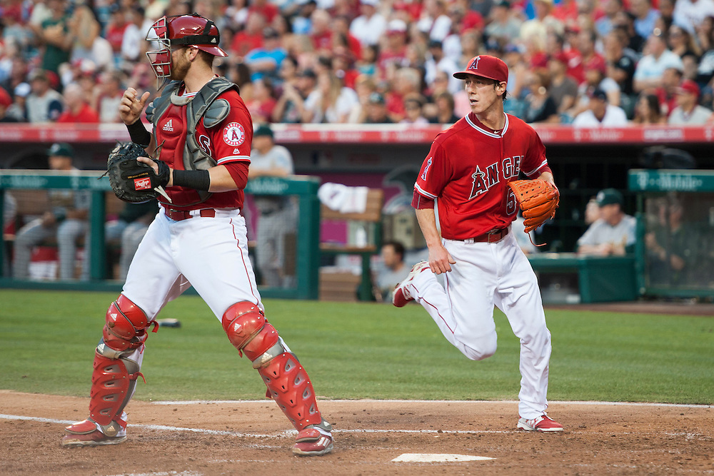 The Angels' Tim Lincecum covers home behind catcher Jett Bandy against the Oakland Athletics at Angel Stadium on Thursday.<br /> <br /> ///ADDITIONAL INFO:   <br /> <br /> angels.0624kjs  ---  Photo by KEVIN SULLIVAN / Orange County Register  --  6/23/16<br /> <br /> The Los Angeles Angels take on the Oakland Athletics Thursday at Angel Stadium.<br /> <br /> <br />  6/23/16