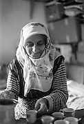 """""""Nana"""" (Bosnian: Grandmother), a female refugee from Bosnia doing turkish coffee at the Varazdin refugee camp in Croatia in the winter of 1992."""