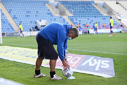 A member of the ground staff places a clean ball on a pod - Mandatory by-line: Arron Gent/JMP - 18/06/2020 - FOOTBALL - JobServe Community Stadium - Colchester, England - Colchester United v Exeter City - Sky Bet League Two Play-off 1st Leg