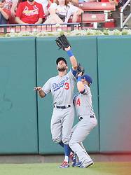 May 31, 2017 - St Louis, MO, USA - Los Angeles Dodgers center fielder Chris Taylor, left, collides with right fielder Kike Hernandez as he catches a fly ball bythe  St. Louis Cardinals' Stephen Piscotty in the second inning on Wednesday, May 31, 2017, at Busch Stadium in St. Louis. The Cards won, 2-1. (Credit Image: © Chris Lee/TNS via ZUMA Wire)