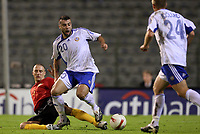 Fotball<br /> Belgia v Finland<br /> Foto: Dppi/Digitalsport<br /> NORWAY ONLY<br /> <br /> FOOTBALL - EURO 2008 - QUALIFYING ROUND - GROUP A - BELGIUM v FINLAND - 13/10/2007 - ALEXEI EREMENKO (FIN) / TIMMY SIMONS (BEL)