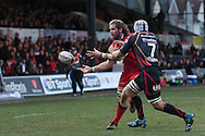 Ben Toolis of Edinburgh passes the ball out wide to his team mate Nasi Manu (not pictured)  as Ollie Griffiths of the Newport Gwent Dragons closes in on him.  Guinness Pro12 rugby match, Newport Gwent Dragons  v Edinburgh rugby at Rodney Parade in Newport, South Wales on Sunday 27th November 2016.<br /> pic by Simon Latham, Andrew Orchard sports photography.