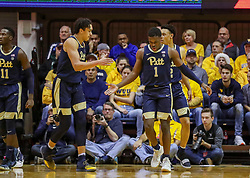 Dec 8, 2018; Morgantown, WV, USA; Pittsburgh Panthers guard Xavier Johnson (1) celebrates with teammates during the first half against the West Virginia Mountaineers at WVU Coliseum. Mandatory Credit: Ben Queen-USA TODAY Sports