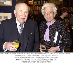 MAJOR EDMUND & MRS DE ROTHSCHILD, at a party in London on 4th April 2002.	OYU 7