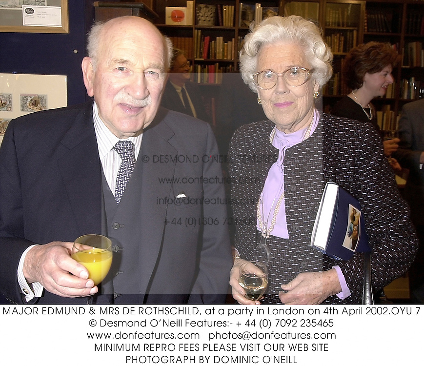 MAJOR EDMUND & MRS DE ROTHSCHILD, at a party in London on 4th April 2002.OYU 7