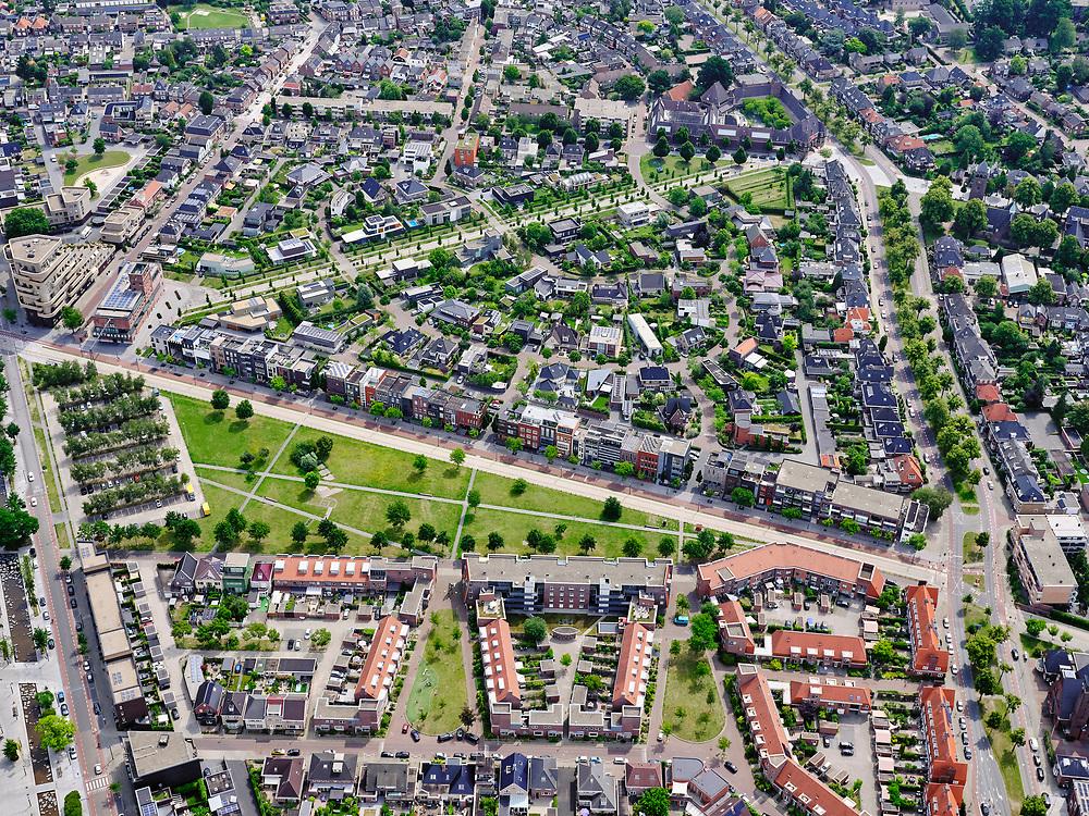 Nederland, Overijssel, Gemeente Enschede; 21–06-2020; overzicht van de woonwijk Roombeek, herbouwd na de vuurwerkramp (S.E. Fireworks). <br /> Diagonaal de Lonneker Spoorlaan (een van de drie assen van Roombeek) met in het groen Monument Vuurwerkramp Enschede (Tollensstraat) en de Museumlaan. Overview of the residential area of Roombeek, rebuilt after the fireworks disaster (S.E. Fireworks).<br /> On the lawn in the middle the Enschede Fireworks Disaster Monument (Tollensstraat)<br /> <br /> luchtfoto (toeslag op standard tarieven);<br /> aerial photo (additional fee required)<br /> copyright © 2020 foto/photo Siebe Swart
