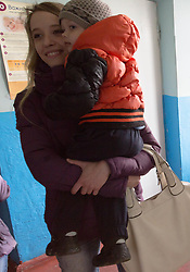 Olga Malishenko, 23, with her son Vladislav, 2yrs 7 months, at the Bolshaya Vergunka polyclinic, Lugansk, where MSF are holding a mobile clinic for local residents.