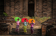novice Buddhist monks with parasols at the Bagan pagoda temples, Myanmar