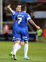 Peterborough United's Danny Swanson celebrates scoring his goal with team-mate Lee Tomlin  - Photo mandatory by-line: Joe Dent/JMP - Tel: Mobile: 07966 386802 27/08/2013 - SPORT - FOOTBALL - London Road Stadium - Peterborough - Peterborough V Reading -  Capital One Cup - Round 2