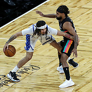 ORLANDO, FL - APRIL 12: Patty Mills #8 of the San Antonio Spurs defends Cole Anthony #50 of the Orlando Magic during the first half at Amway Center on April 12, 2021 in Orlando, Florida. NOTE TO USER: User expressly acknowledges and agrees that, by downloading and or using this photograph, User is consenting to the terms and conditions of the Getty Images License Agreement. (Photo by Alex Menendez/Getty Images)*** Local Caption *** Patty Mills; Cole Anthony