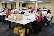 02 NOVEMBER 2020 - DES MOINES, IOWA: Elections workers open and sort mail in ballots at the Polk County Auditor's Office in Des Moines Monday. Officials started opening mail in ballots Monday morning but won't start counting ballots until Tuesday morning. This is the last day of early voting before the 2020 US presidential election. The line to vote at the Polk County Auditor's Office was 4 blocks long Monday morning. An elections official said that by November 3, which is Election Day, about 45 percent of the registered voters in Polk County will have already voted.    PHOTO BY JACK KURTZ