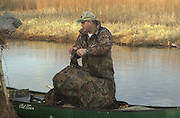 James Pratt setting duck decoys on lake