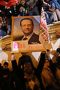 """Rally for the winner of the French Presidential elections, incoming President Francois Hollande of the Socialist Party at the Bastille, Paris, on Sunday night May 7th 2012. Francois Hollande beat Nicolas Sarkozy 52% to 48% in the second and final round of the French Presidential Elections///Socialist Party supporters holding a portrait of Francois Hollande reading """"Moi President"""", with flags reading change """"Changement"""""""