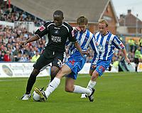 Photo: Andrew Unwin.<br />Hartlepool Utd v Swansea. Coca Cola League 1.<br />17/09/2005.<br />Hartlepool's Antony Sweeney (C) looks to tackle Swansea's Marcus Bean (L).