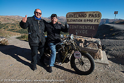 Ciro Nisi (R) of Italy poses with his 1924 Moto Guzzi Sport and his fellow Italian Cannonballer Giuseppe Savoretti for a photo while crossing the Continental Divide at the top of Loveland Pass during Stage 10 (278 miles) of the Motorcycle Cannonball Cross-Country Endurance Run, which on this day ran from Golden to Grand Junction, CO., USA. Monday, September 15, 2014.  Photography ©2014 Michael Lichter.