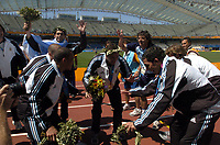28/08/04 - ATHENS - GREECE -  - OLYMPIC FOOTBALL - FINAL MATCH - MENS  -  <br />ARGENTINA (1) Vs. PARAGUAY (0) At the Olympic Stadium in Athens. Argentine win the goal medal<br />Argentine players dancing during the celebration. = From Left to right - AYALA - KILLY GONZALEZ - CARLSO TEVEZ<br />© Gabriel Piko / Argenpress.com / Piko-Press