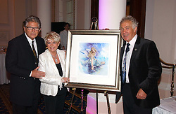 Left to right, GLORIA HUNNIFORD, her husband STEPHEN WAY and artist GORDON KING at a reception to launch Angel themed Christmas Cards and view an exhibition of the original art work by Gordon King with proceeds going to the Caron Keating Foundation  held at the Langham Hotel, Portland Place, London on 20th November 2006.<br />