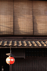 Detail of traditional wooden house with bamboo shutters in historic Gion district of Kyoto in Japan