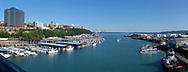 Panorama view from the Murray Morgan bridge over the Foss Waterway looking toward Commencement Bay with Tacoma, WA on the left and the port of the right, Thursday, July 25, 2019. (Photo/John Froschauer)