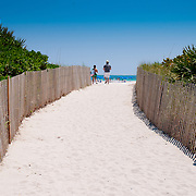 People coming to the South Beach between two fences, Miami, Florida