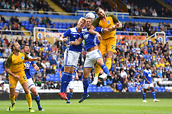 Birmingham City's captain Michael Morrison (centre) and Birmingham City's Maikel Kieftenbeld compete for a header against Brighton & Hove Albion's Shane Duffy during the pre-season friendly match at the St Andrew's Trillion Trophy Stadium, Birmingham.