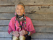 Portrait of an elderly Kayaw ethnic minority woman wearing traditional clothing outside her home in Ya A Pra village, Kayah State, Myanmar on 21st November 2016. Myanmar is one of the most ethnically diverse countries in Southeast Asia with 135 different indigenous ethnic groups with over a dozen ethnic Karenni subgroups in the Kayah region