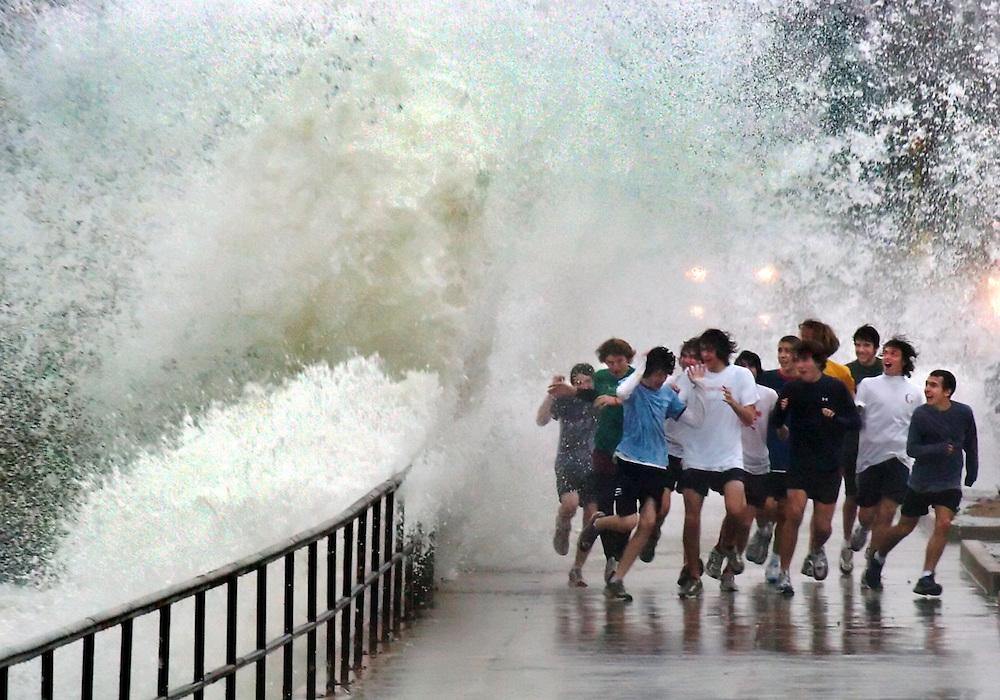 Gloucester: Jan 18, 2006. Nor'easter, big waves along Stacey Boulevard, track team running through wave.