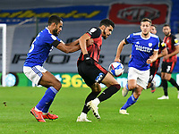 Football - 2020 / 2021 Sky Bet Championship - Cardiff City vs AFC Bournemouth - Cardiff City Stadium<br /> <br /> Dominic Solanke of Bournemouth held by Curtis Nelson of Cardiff City<br /> in a match played without fans<br /> <br /> COLORSPORT