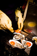 Oysters with egg being cooked at a food-stall in Hanoi, Vietnam, Asia