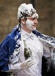 © Licensed to London News Pictures. 04/06/2021. Oxford, UK. A students at Oxford University covered in foam and holding a bottle of champagne after celebrating finishing  final exams, in a tradition known as 'trashing'. Oxford University is attempting to clamp down on the tradition which sees students throwing food, confetti and drink over their classmates. Photo credit: Ben Cawthra/LNP