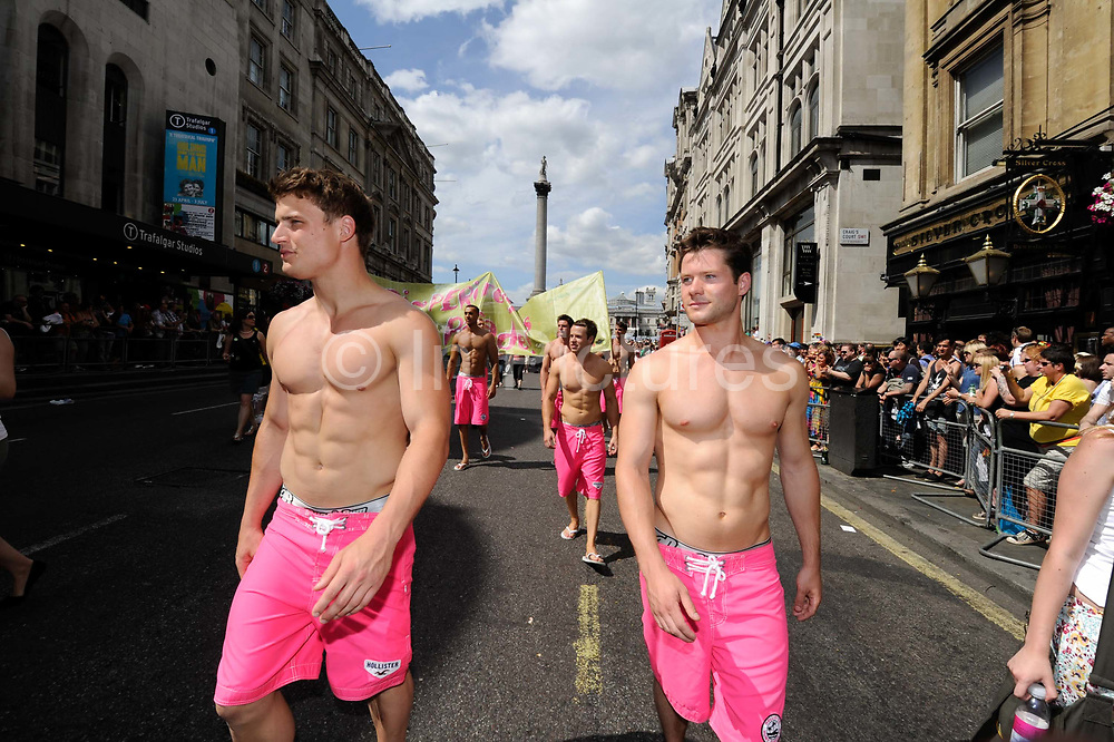 People take part in the annual Gay Pride street march through central London on July 2010. The parade includes around 40 floats interspersed with marching groups, dancing groups, bands and thousands of other participants.