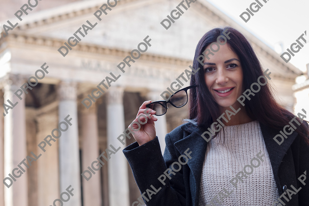 Suscessful tourist woman hold glasses and smile at Pantheon in Rome