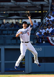 March 29, 2018 - Los Angeles, CA, U.S. - LOS ANGELES, CA - MARCH 29: Los Angeles Dodgers Shortstop Corey Seager (5) leaps and catches a pop fly during the MLB opening day game between the San Francisco Giants and the Los Angeles Dodgers on March 29, 2018 at Dodger Stadium in Los Angeles, CA. (Photo by Chris Williams/Icon Sportswire) (Credit Image: © Chris Williams/Icon SMI via ZUMA Press)