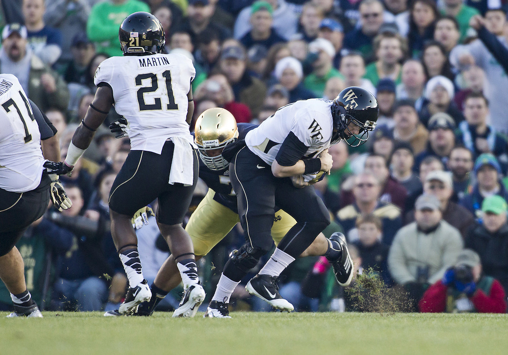 November 17, 2012:  Wake Forest quarterback Tanner Price (10) is sacked by Notre Dame defensive end Stephon Tuitt (7) during NCAA Football game action between the Notre Dame Fighting Irish and the Wake Forest Demon Deacons at Notre Dame Stadium in South Bend, Indiana.  Notre Dame defeated Wake Forest 38-0.