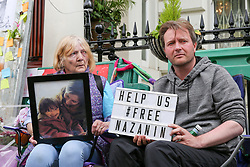 """© Licensed to London News Pictures. 21/06/2019. London, UK. Barbara Redcliffe (L) mother of Richard Ratcliffe (L), the husband of imprisoned Iranian-British national Nazanin Zaghari-Ratcliffe on the seventh day of a hunger strike outside the Iranian Embassy in London in solidarity with his wife, who is refusing to eat in protest at her """"unfair imprisonment"""" in Iran on spying charges. Photo credit: Dinendra Haria/LNP"""