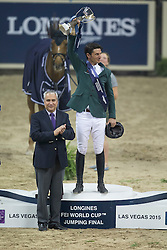 Guerdat Steve, (SUI) winner of the Longines FEI World Cup™ Jumping Final receiving the cup from Ingmar Devos, President of the FEI<br /> Las Vegas 2015<br />  © Hippo Foto - Dirk Caremans<br /> Final III round 2 20/04/15