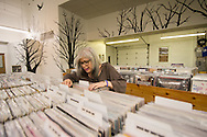 Judy Mills, owner of Mills Record Company peruses vinyl
