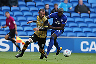 Sol Bamba of Cardiff city  ® challenges Steven Fletcher of Sheffield Wed (l). .EFL Skybet championship match, Cardiff city v Sheffield Wednesday at the Cardiff City Stadium in Cardiff, South Wales on Saturday 16th September 2017.<br /> pic by Andrew Orchard, Andrew Orchard sports photography.