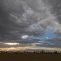 The sun sets over a tourist ger camp in the Gobi Desert near Dalanzadgad, Mongolia.