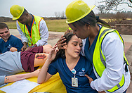 Victim Jennifer Moylett, is hugged by first responder Purity Mwangi (right) during a haz-mat bombing drill  Tuesday, January 14, 2020 at Holy Family University in Newtown, Pennsylvania. The goal is to educate nursing students as to the role they could potentially play in a similar emergency situation. (WILLIAM THOMAS CAIN/PHOTOJOURNALIST)
