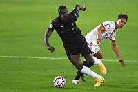 SEVILLE, SPAIN - OCTOBER 28: Oliver Torres of FC Sevilla and Sehrou Guirassy of Stade Rennais during the UEFA Champions League Group E stage match between FC Sevilla and Stade Rennais at Estadio Ramon Sanchez-Pizjuan on October 28, 2020 in Seville, Spain. (Photo by Juan Jose Ubeda/ MB Media).