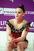 Araujo Rita sitting at the Kiss and Cry of the Rhythmic Gymnastics World Cup in Pesaro.