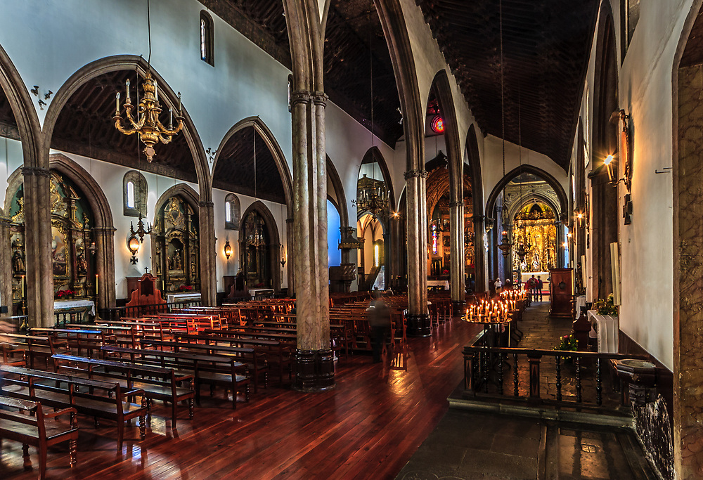 The interior of Cathedral of Funchal in Madeira, Portugal. The ceiling is Moorish carved cedar inlaid with ivory, and behind the Baroque altar are paintings by Flemish and Portuguese artists.