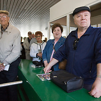 (PPAGE1) Oceanport 5/14/2005 Michael Fleming along with his wife Lana of Cranford (right) were one of the first people in line as they waited for the Monmouth Park Race Track to open.   Michael J. Treola Staff Photographer....MJT